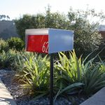 white and red mide century modern mailbox idea with black metal stand