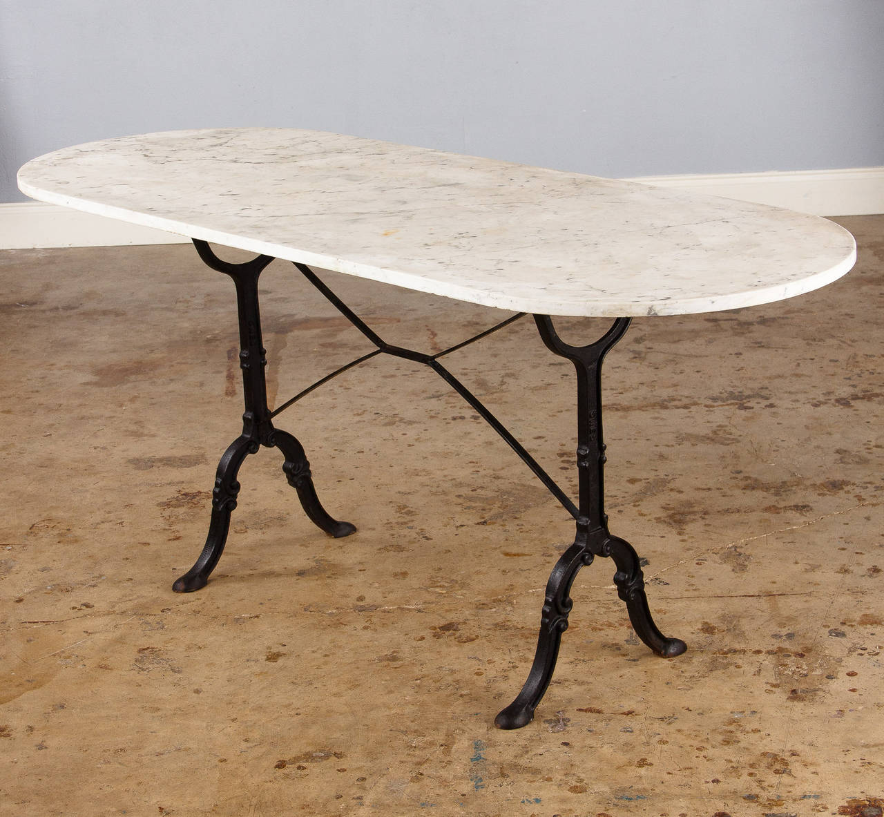 Genial White Marble Bistro Table With A Pair Of Black Wrought Iron Legs