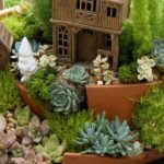 wondrous and unique succulent planter design idea with peach pot with landscape and tiny house and shrub