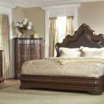 A fancy bedroom set idea with dark brown bed frame plus headboard a larger bedside table a bedroom vanity with mirror and table lamp white bedroom rug