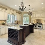A kitchen island with wine rack and white granite countertop a pair of classic pendant chandelier white kitchen countertop white wall kitchen cabinet system and white under kitchen cabinets