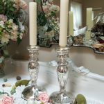 A pair of candlestick stands as decoration as well as functional items