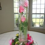 A transparent glass vase with flower and gel as the fillers
