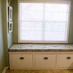 Bay Window Seats With Storage And Shades On Window