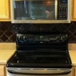 Black Beveled Arabesque Tile On Kitchen Wall