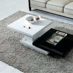 Black and white center table for a modern living room grey shag area rug idea for a modern living room simple sofa