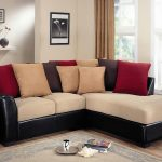 Black leather sectional with cream cushion and colorful accent pillows