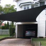 Black shade sail DIY as the carport