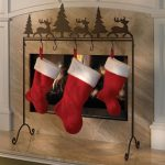 Christmas-stocking-holder-stand-wrough-iron-stand-fireplace-decoration-with-simple-design-also-with-5-hooks-placed-near-fireplace-but-no-mantel