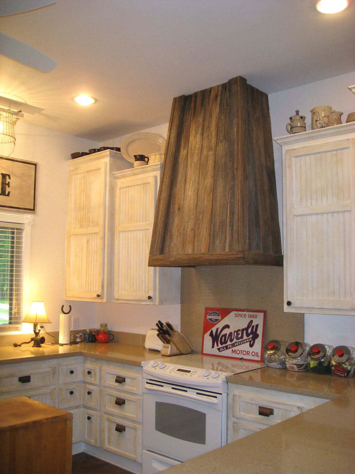 Classic Wood Vent Hood With White Kitchen Cabinet Set