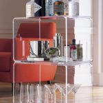 Clear acrylic accent table with casters as movable kitchen cart for wine