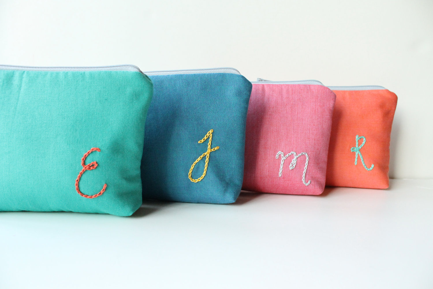 Colorful Of Monogrammed Cosmetic Bags With Letter Design