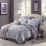 Comforter cover from IKEA with classic floral motif a bed frame with headboard white bedside table in classic style
