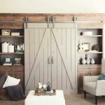 Cool rustic entertainment center with door and shelves plus base storage an armchair in grey white ottoman table