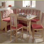 Corner Bench Kitchen Set In Vintage Style With Comfy Red Cushion A Wood Table And A Pair Of Red Cushioned Wood Chairs