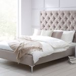 Cream Color Of Tall Upholstered Bed And White Bedding