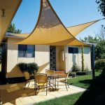 Cream shade sail DIY for home front yard a set of furniture consisting of round glass table and four chairs