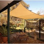 Cream Shade Sail Designed By DIY For Patio A Set Of Unfinished Wood Patio Furniture Consisting Of Several Benches And Round Top Table