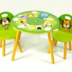 Cute green round top table with  cute animal pictures a pair of cute wood chairs with animal picture in green color