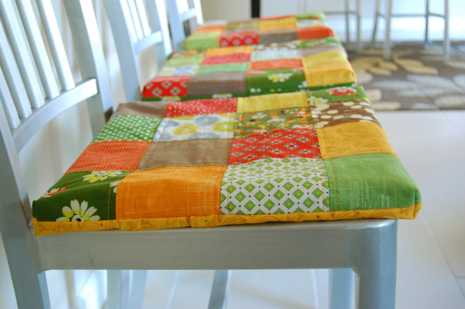 DIY Cute Dining Room Seat Cushions With Colorful Fabrics Decorated On The Top Of White Wooden