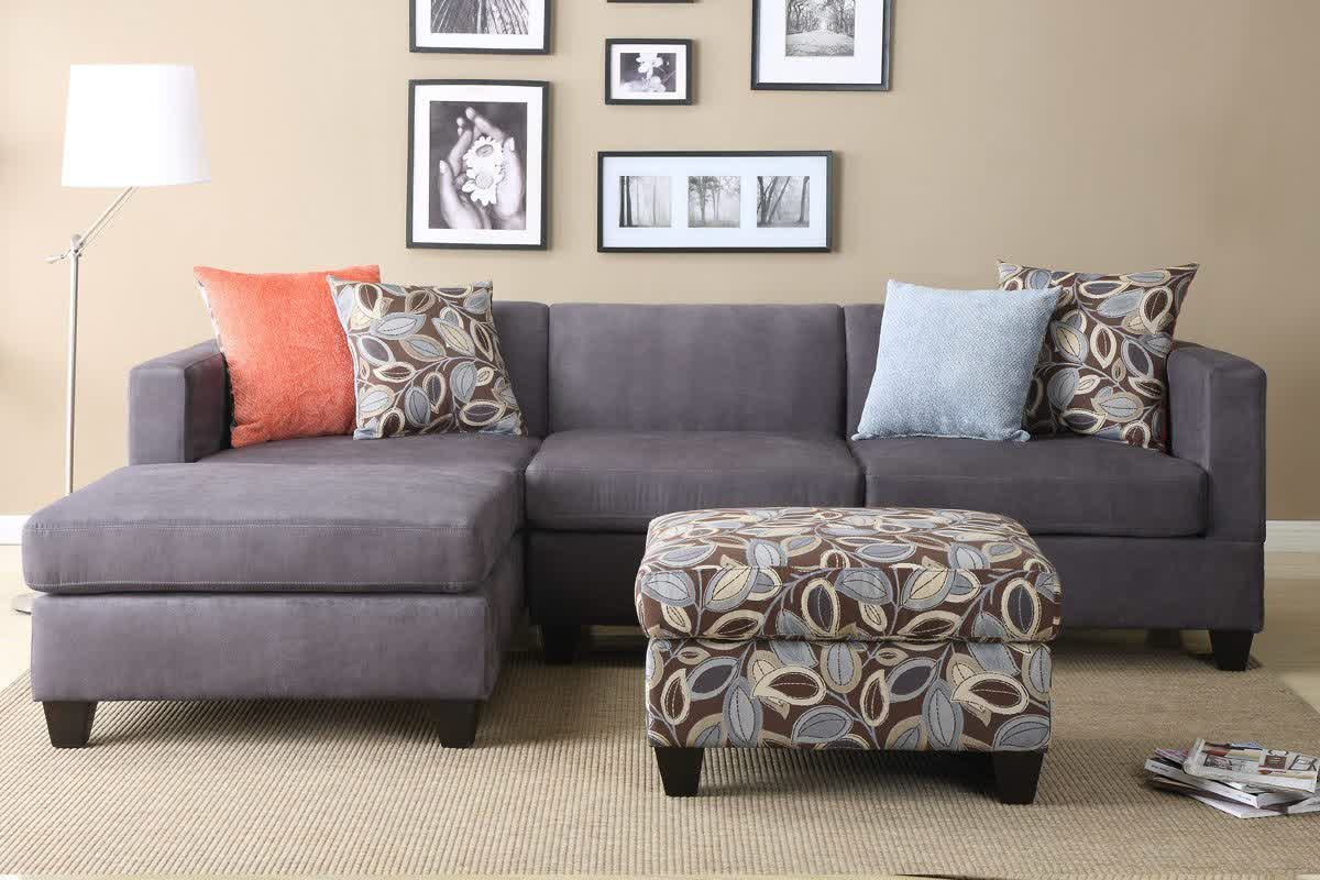 Dark Grey Apartment Sized Sectional Idea With Multi Color Accent Pillows  And Floral Patterned Ottoman Table