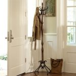 Dark wood standing coat hanger with black metal base