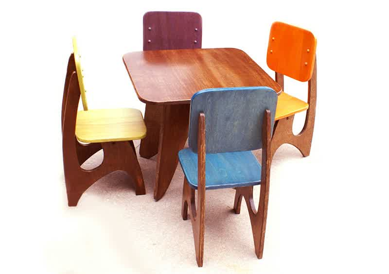 Dark Wooden Table And Colorful Wood Chairs For Kids