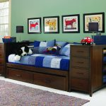 Drak Wooden Daybeds with Storage And Trundle Blue Bedding On Bed And Pillows