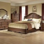 Elegant fancy bed set design with hardwood bed frame plus headboard dark brown coated wood bedside table a bedroom vanity with wood framed mirror classic bedroom rug