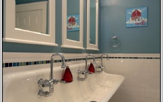 Extra size white kohler bathroom sink with three units of water faucets and three units of white framed mirrors