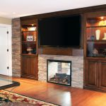 Furniture In Wall Entertainment Center With Stone Wall And Fireplace
