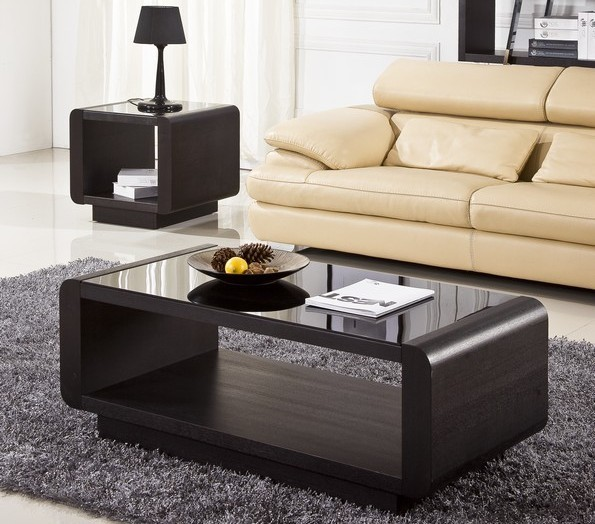 glass top coffee table as the center piece in a living room