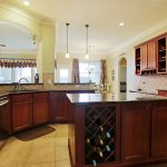 Glass top kitchen island with under wine storage idea