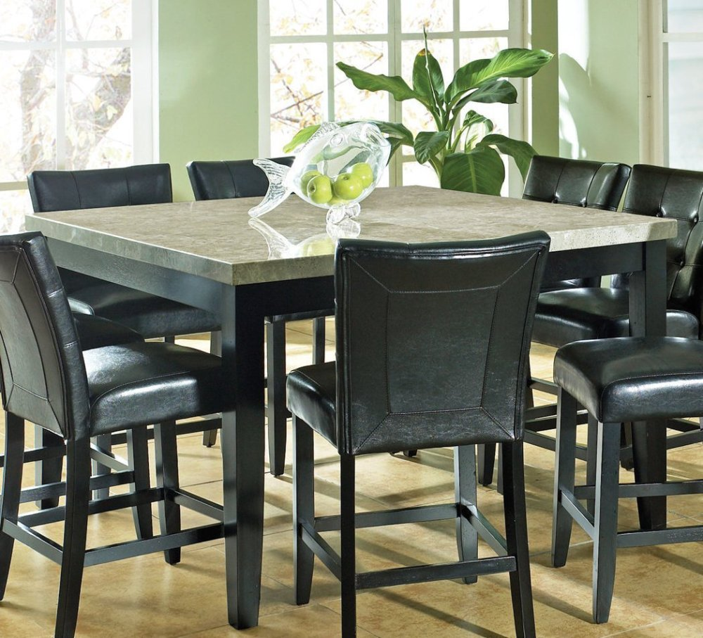 granite dining table set with many black chairs