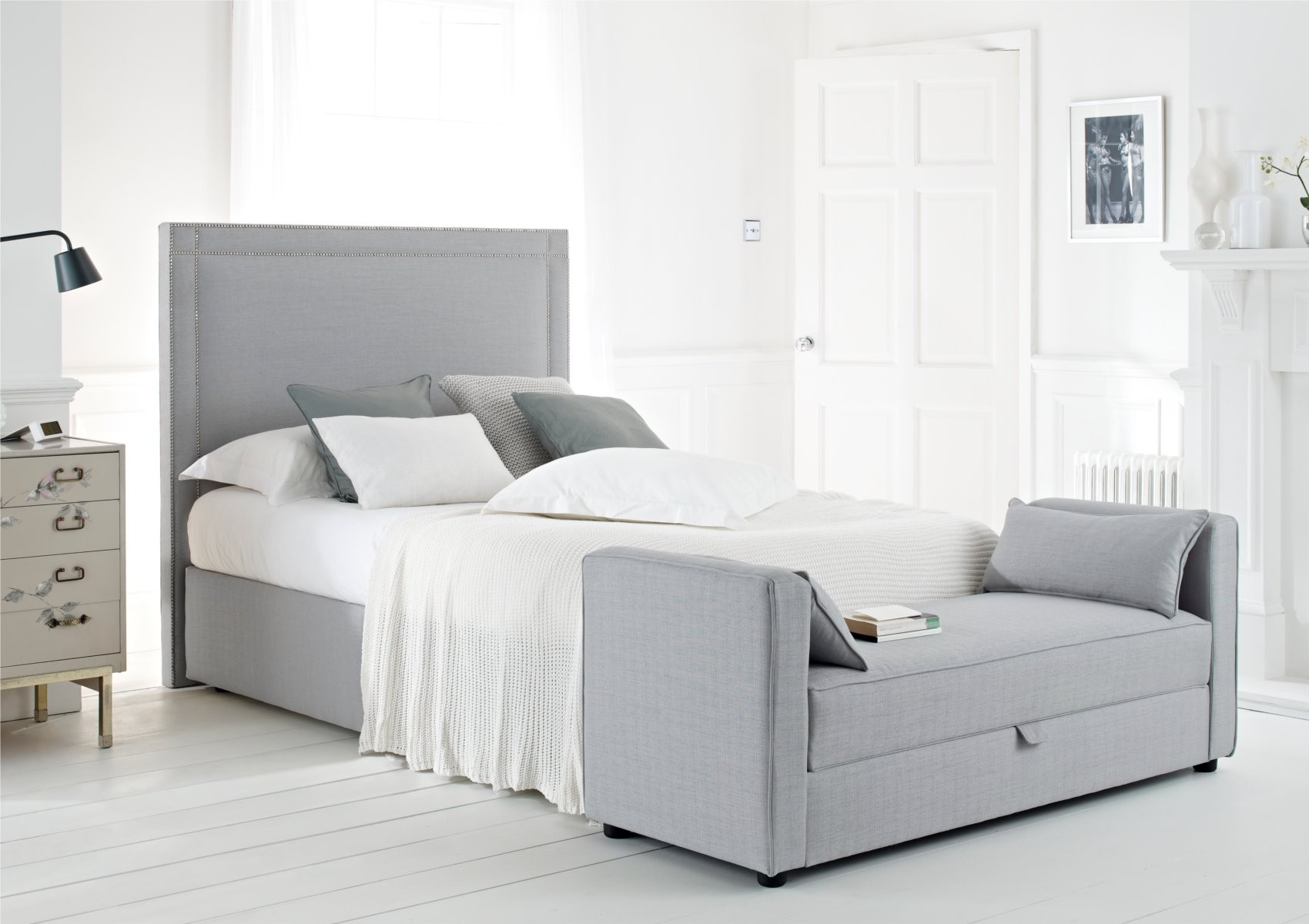 Grey Tall Upholstered Bed Frame White Bedding And Additional Bench