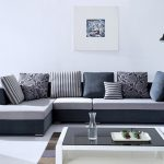 Grey White Sectional Sofa Designs For Living Room With Stripped Pillow Floor Lamp And White Glass Table