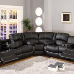 Half round black leather sectional recliner grey shag area rug with two piles of books