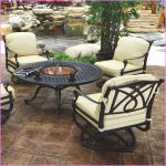 Hampton bay fire pit table design in round shape four sets of patio chairs with white cushions