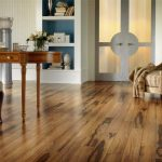 Hardwood Floor VS Laminate For Room Floor With Wooden Desk And Accent Chair