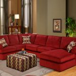 L shaped red microfiber sectional with chaise and accent pillows an ottoman table with slipcover modern area rug