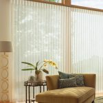 Layered Glass Door Coverings With Sleeper Chair
