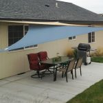 Light blue shade sail from DIY a set of outdoor furniture in backyard