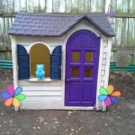 Little Tikes Playhouse Idea With A Pair Of Flower Decoration