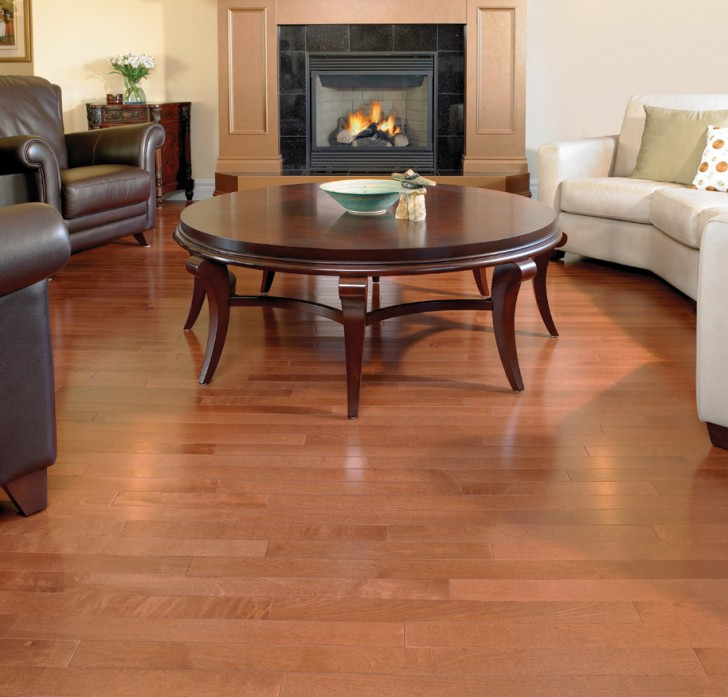 Living Room Idea With Hardwood Floor VS Laminate And Round Coffee Table Plus Fireplace