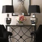 Living Room Wrought Iron Sofa Table With Double Lamps And Black Chairs