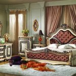 Luxurious fancy bed set in classic style a pair of bedside tables and table lamps a bedroom vanity unit with framed mirror shaggy white rug