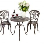 Metal Ikea Bistro Set With Wine And Flower On It