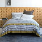 Mid Century Modern Bedding Cover With Monochromatic Strip Patterns Simple White Round Top Side Table Textured Wood Wall System As Wall Accent