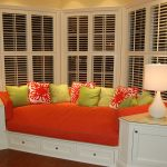 Modern Whiite Window Seats With Storage On Bay Window With Double Table Lamps