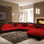Modern red microfiber sectional with black decorative pattern  grey shaggy rug wall mounted TV set unique floor lamp in white color modern fireplace unit with concrete mantel